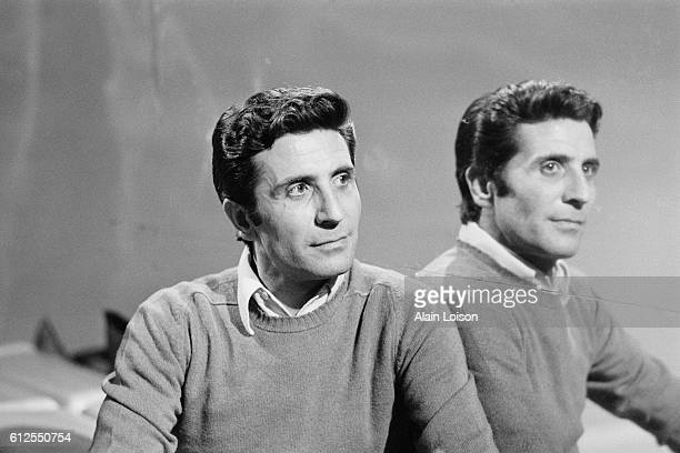 French singer and songwriter Gilbert Becaud on the set of a television show