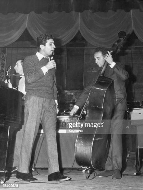 French singer and songwriter Gilbert Becaud rehaersing at the Olympia Theatre Paris 17th November 1964