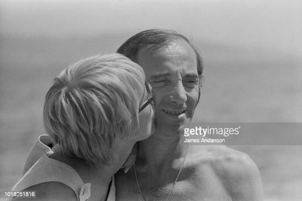 French singer and songwriter of Armenian origin Charles Aznavour with his third wife Swede Ulla Thorsell on holiday in the South of France 19th July...