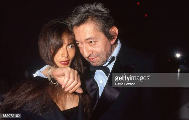 French singer and songwriter Serge Gainsbourg and his partner Bambou attend the 1990 Victoires de la Musique ceremony Serge Gainsbourg will receive...