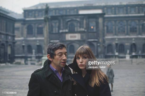 French singer and songwriter Serge Gainsbourg and his partner British singer and actress Jane Birkin in the courtyard of the French National College...