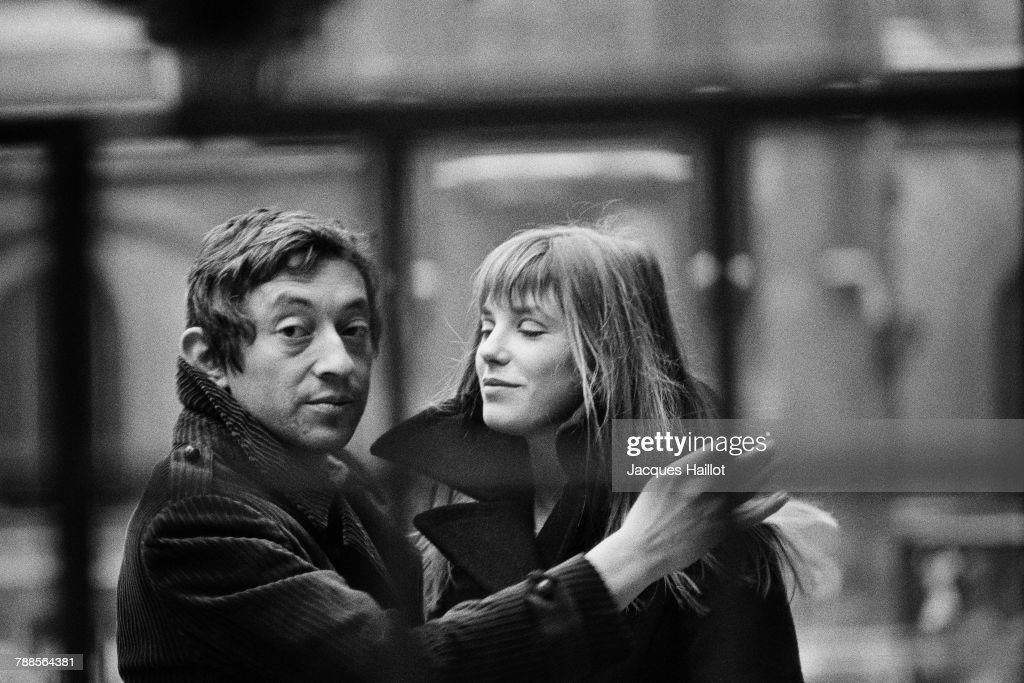 French singer and songwriter Serge Gainsbourg and his partner British singer and actress Jane Birkin in the courtyard of the French National College of Fine Arts, in Paris.