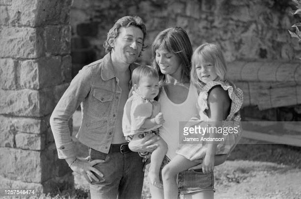 French singer and songwriter Serge Gainsbourg with British singer and actress Jane Birkin, who holds in her arms her daughters, Charlotte and Kate...