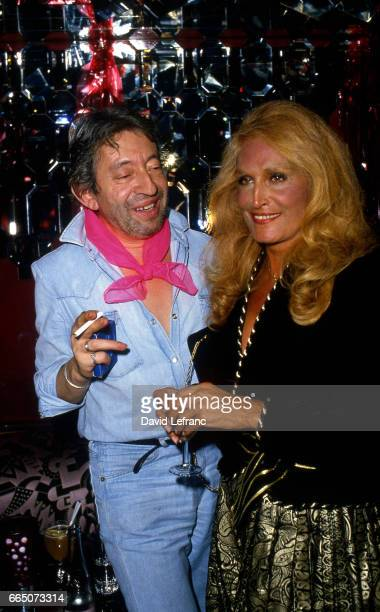 French singer and songwriter Serge Gainsbourg with FrenchItalian singer Dalida at Chez Régine nightclub in Paris