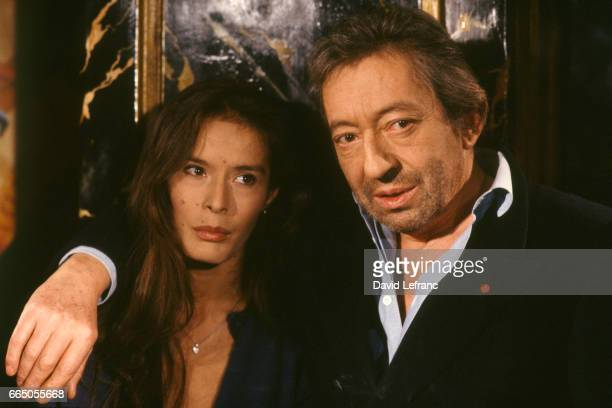 French singer and songwriter Serge Gainsbourg with his partner Bambou on the television set of Lunettes noires pour nuits blanches hosted by Thierry...