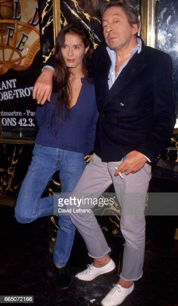 French singer and songwriter Serge Gainsbourg with his partner Bambou on the set of the TV show Lunettes noires pour nuits blanches hosted by Thierry...