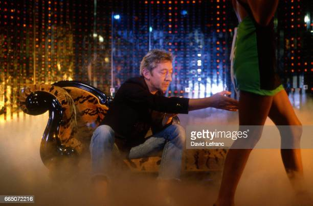 French singer and songwriter Serge Gainsbourg with his partner Bambou on the set of the videoclip of his song Love on the Beat at the Scala concert...