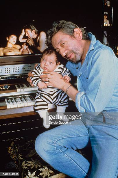 French singer and songwriter Serge Gainsbourg with his son Lulu in their Paris home on Rue de Verneuil