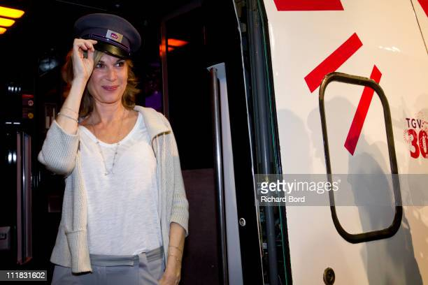 French singer and special guest Michele Laroque poses in front of the TGV Train during the SNCF presentation at Gare Montparnasse on April 7 2011 in...