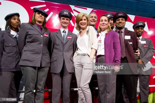 French singer and special guest Michele Laroque poses with the SNCF crew during the SNCF presentation at Gare Montparnasse on April 7 2011 in Paris...