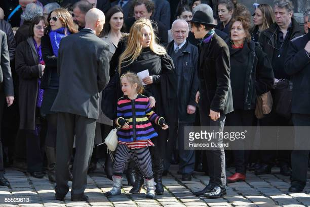 French singer and wife of Alain Bashung, Chloe Mons, her daughter Poppee, and Arthur Bashung leave the Saint-Germain-des-Pres church after a funeral...