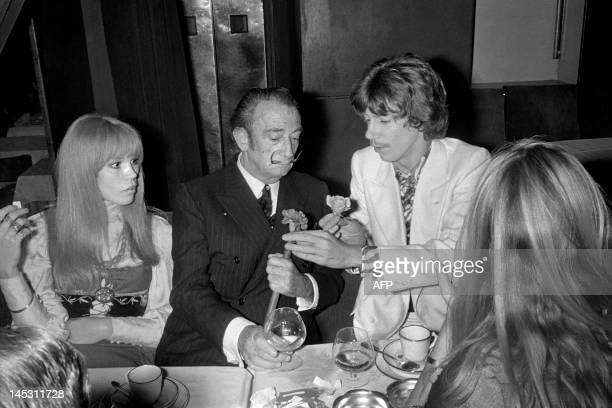 French singer Antoine offers a rose to Spanish artist Salvador Dali giving him the carnation of his buttonwhole on December 9 1967 after his concert...