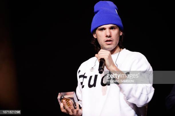 French singer Aurelien Cotentin aka Orelsan celebrates after receiving the 'Rolf Marbot award for the best song of the year' during the SACEM Grand...