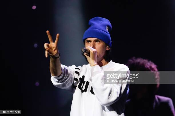 French singer Aurelien Cotentin aka Orelsan performs on stage after receiving the 'Rolf Marbot award for the best song of the year' during the SACEM...
