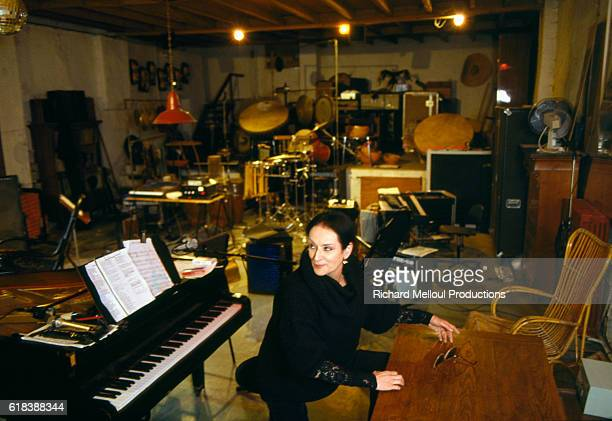 French Singer Barbara looks over her shoulder in her in her home music room