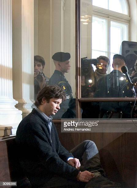 French singer Bertrand Cantat sits in court on the opening day of his trial on March 16 2004 in Vilnius Cantat is charged with murdering his movie...