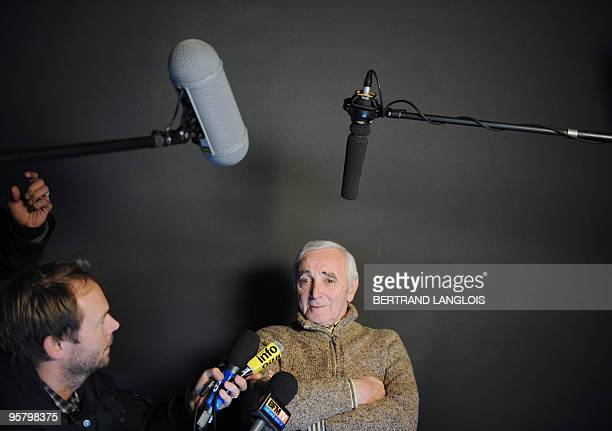 French singer Charles Aznavour addresses journalists after recording with a dozen of French rappers and pop stars a music video to raise funds for...
