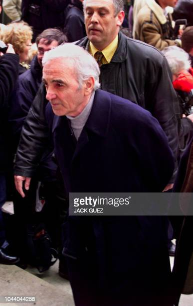 French singer Charles Aznavour arrives at the funeral of French singer and songwriter Charles Trenet at the Madeleine church in Paris 23 February...