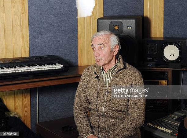 French singer Charles Aznavour gives an interview after recording with a dozen of French rappers and pop stars a music video to raise funds for...