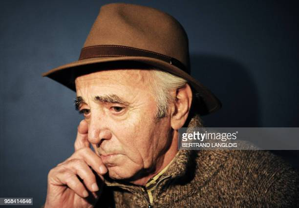 French singer Charles Aznavour gives an interview after recording, with a dozen of French rappers and pop stars, a music video to raise funds for...