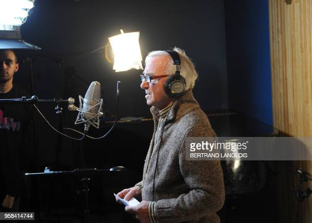 French singer Charles Aznavour is pictured while recording, with a dozen of French rappers and pop stars, a music video to raise funds for...