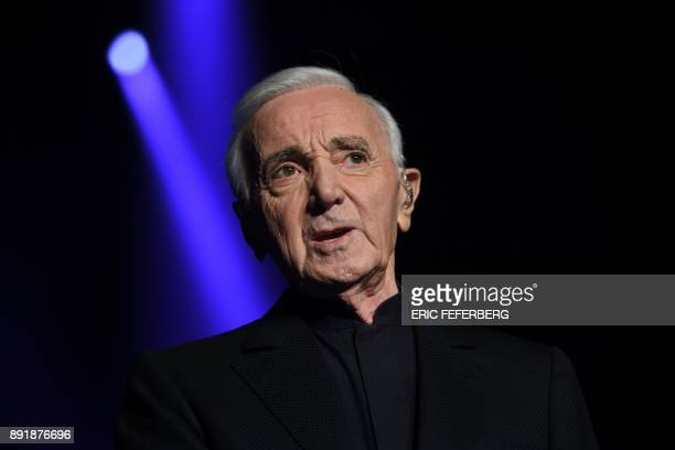 French singer Charles Aznavour perfoms on stage at the Bercy AccorHotels Arena on December 13 2017 in Paris