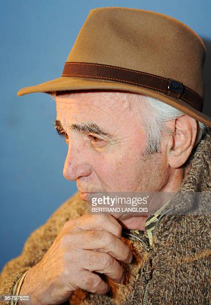 French singer Charles Aznavour performs for a clip as part of a recording with a dozen of French rappers and pop stars a music video to raise funds...