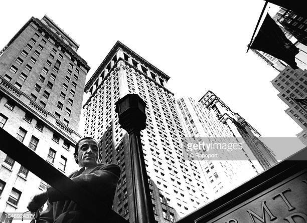 French singer Charles Aznavour poses for a portrait on Wall Street in 1965 in New York City New York