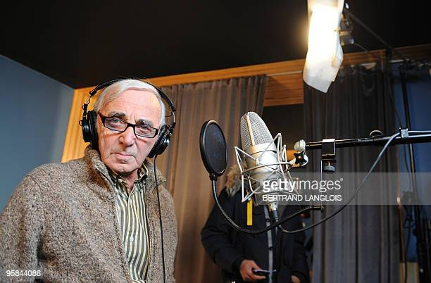 French singer Charles Aznavour poses while recording with a dozen of French rappers and pop stars a music video to raise funds for quakestricken...