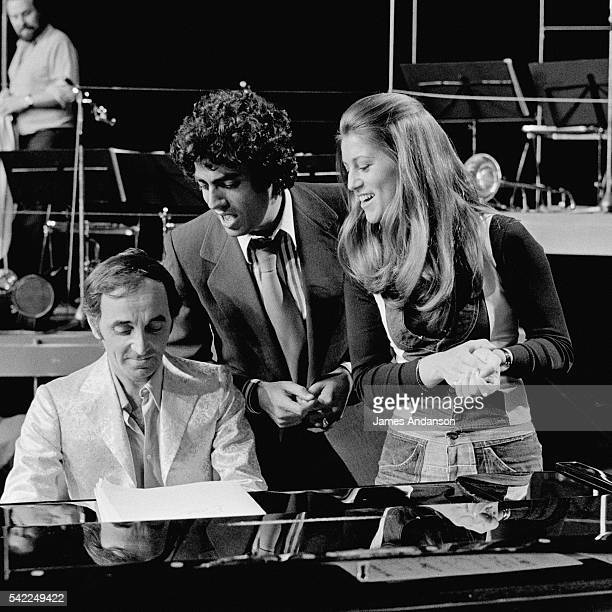French singer Charles Aznavour singing and playing piano with French singers Enrico Macias and Sheila for the ORTF TV show on Channel 2 Top à Charles...