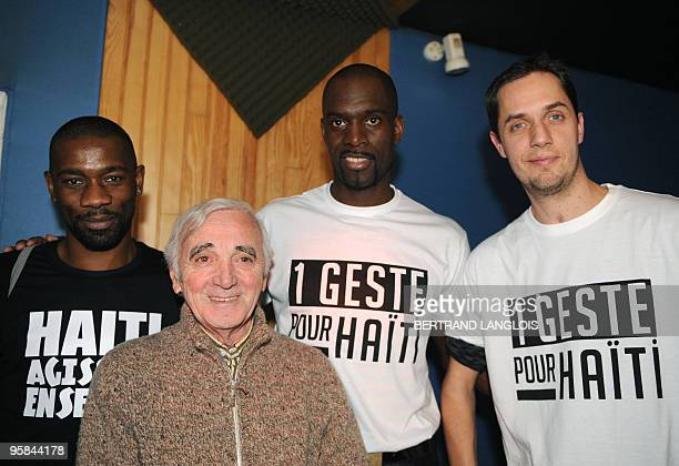 French singer Charles Aznavour Slam poet Grand Corps Malade former Taekwondo champion Pascal Gentil and rapper Passi pose while recording with a...