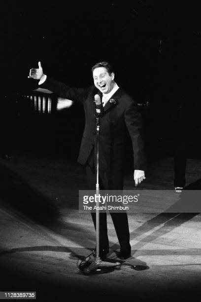 French Singer Charles Trenet performs at Kyoritsu Kodo Hall on March 6, 1959 in Tokyo, Japan.