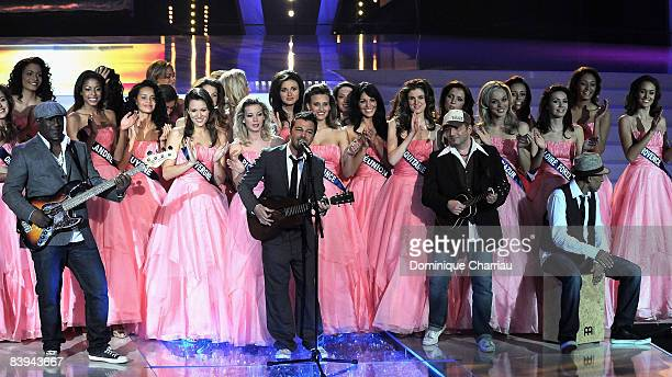 French singer Christophe Mae perform on stage surrounded by miss during the Miss France Pageant 2009 on December 6, 2008 at Le Puy du Fou, France