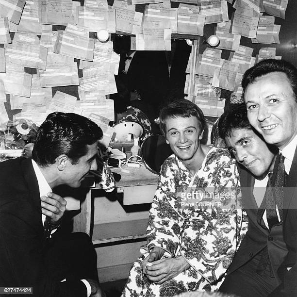 French singer Claude Francois in his dressing room at the Olympia with singers Gilbert Becaud and Sacha Distel and actor Maurice Biraud