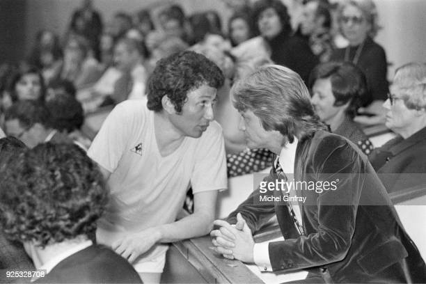 French singer Claude François is attending as president of the tournament a volleyball match between journalists and artists He is talking to Michel...