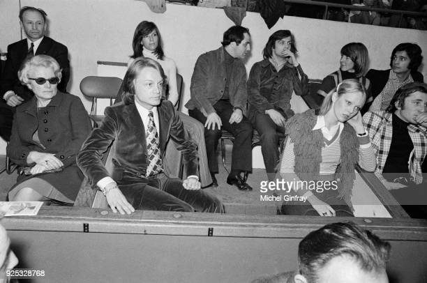 French singer Claude François is attending as president of the tournament with his girlfriend Sofia Kiukkonen a volleyball match between journalists...