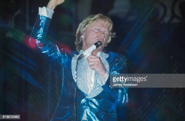 French singer Claude François performing on stage