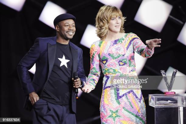 French singer Claude M'Barali aka MC Solaar acknowledges receiving the Best Album of the Year award as French Tv host Daphne Burki speaks during the...
