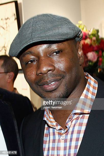 French singer Claude M'Barali aka MC Solaar attends the Jiang Shanqing Exhibition At La Galerie '12 Drouot on May 20 2014 in Paris France