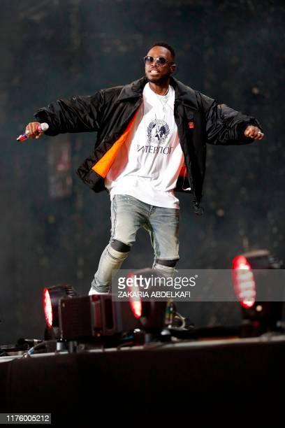 "French singer Dadju Djuna Nsungula aka Dadju performs as a guest during the ""Fuego Tour"" at the Stade de France in Saint-Denis, near Paris on..."