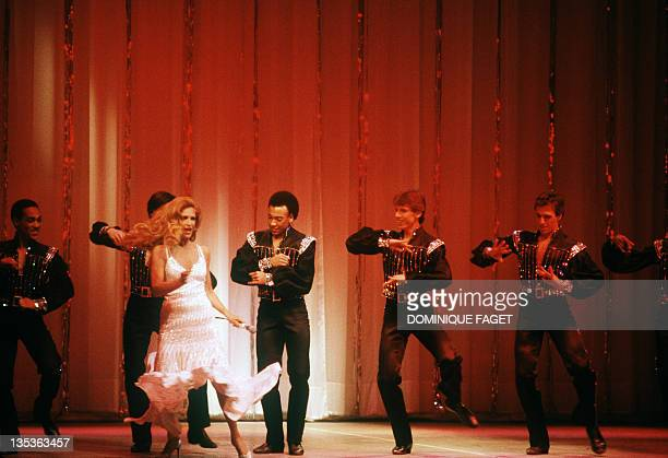 French singer Dalida surrounded by dancers performs 18 March 1981 at Olympia musichall in Paris Dalida was an Egyptianborn singer of Italian origin...