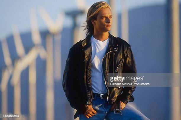 French singer David Hallyday looks into the distance near a line of wind turbines in Palm Springs. David is the son of the legendary French musician...