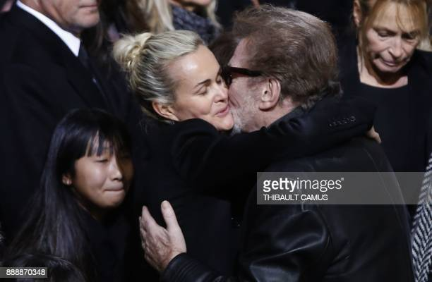 French singer Eddy Mitchell embraces Laeticia Hallyday wife of late French singer Johnny Hallyday during the funeral ceremony of Johnny Hallyday at...