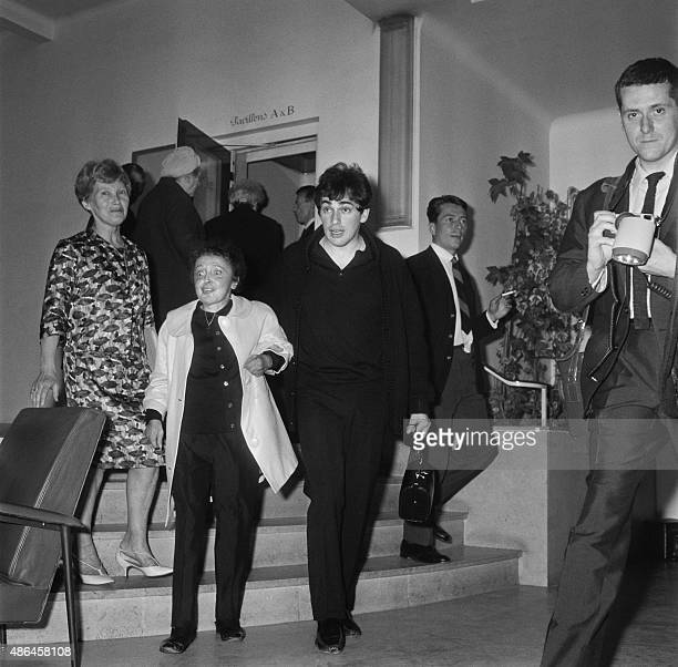 French singer Edith Piaf accompanied by her husband Theo Sarapo leaves the Ambroise Paré clinic on May 27 1963 in Neuilly after a eightweek cure