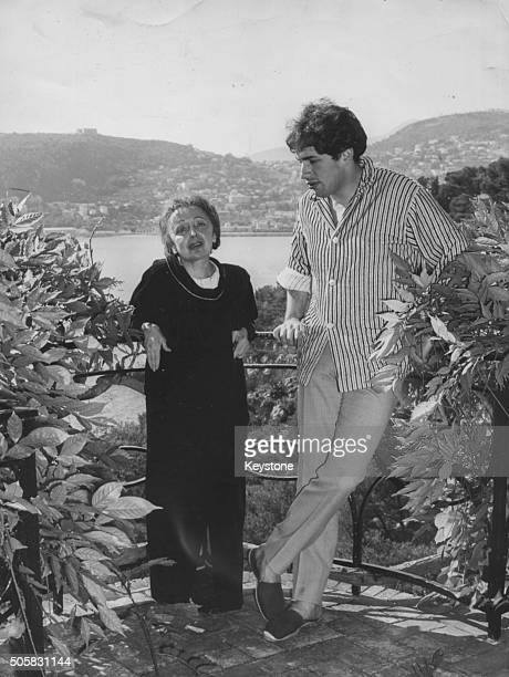 French singer Edith Piaf and her husband Theo Sarapo pictured on a balcony overlooking the sea during her convalescence at the villa 'La Serene' at...