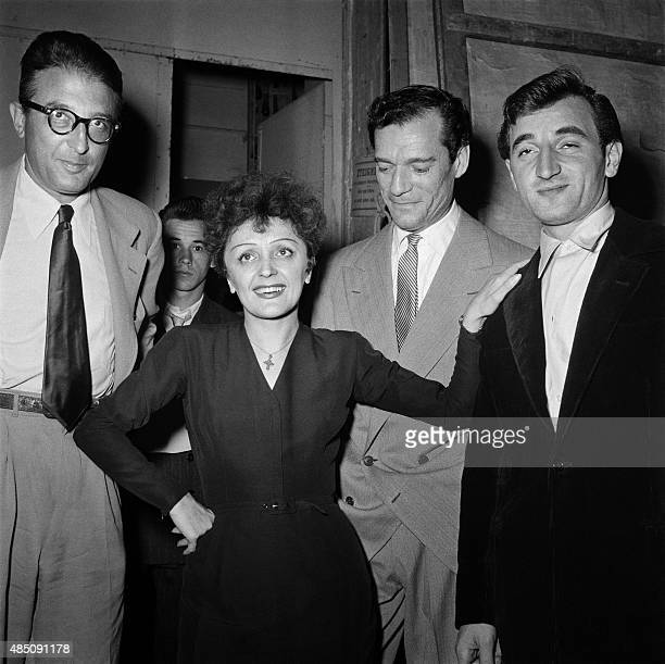 French singer Edith Piaf poses with French composer Michel Emer American actor Eddie Constantine and French singer Charles Aznavour in 1950 in Paris