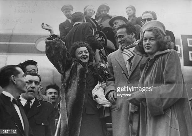 French singer Edith Piaf with boxer Marcel Cerdan and Mathilda Nail arrives at Orly Airport Paris