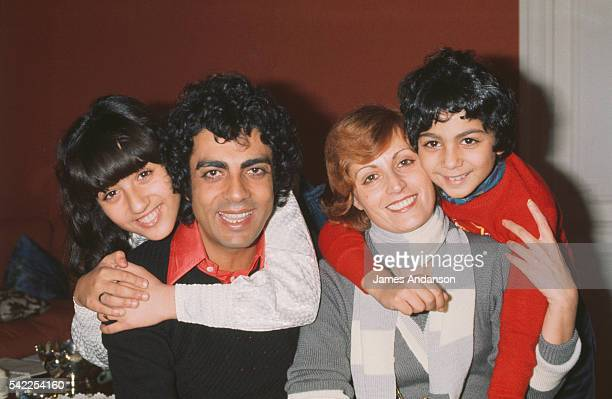 French singer Enrico Macias and his wife Suzy at home being embraced by their daughter Jocya and son, Jean-Claude Ghrenassia, who would later become...
