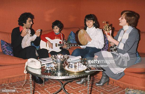 French singer Enrico Macias and his wife Suzy playing music and singing at home with their daughter Jocya and son JeanClaude Ghrenassia who would...