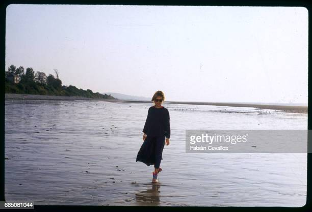 French singer France Gall on a beach while on vacation